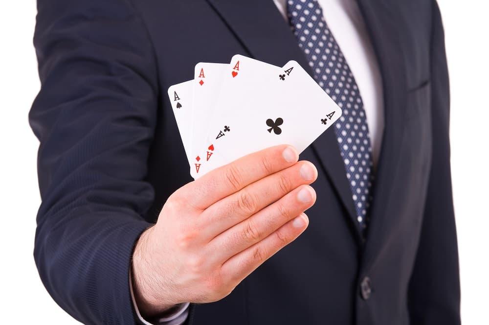 Businessman showing playing cards - gambling career